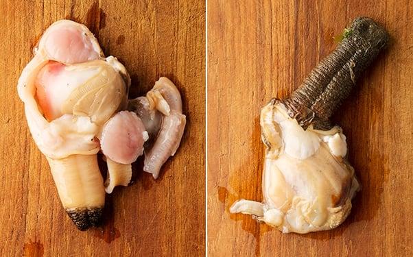 shucked gaper clams on a cutting board