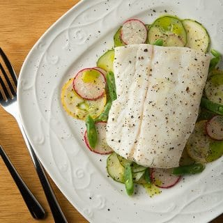 butter poached halibut on a summer salad