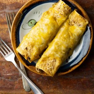 Two green chile enchiladas on a plate