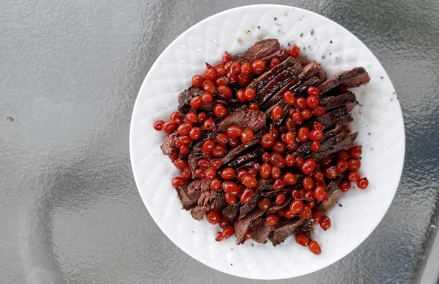 Sage grouse with red currants