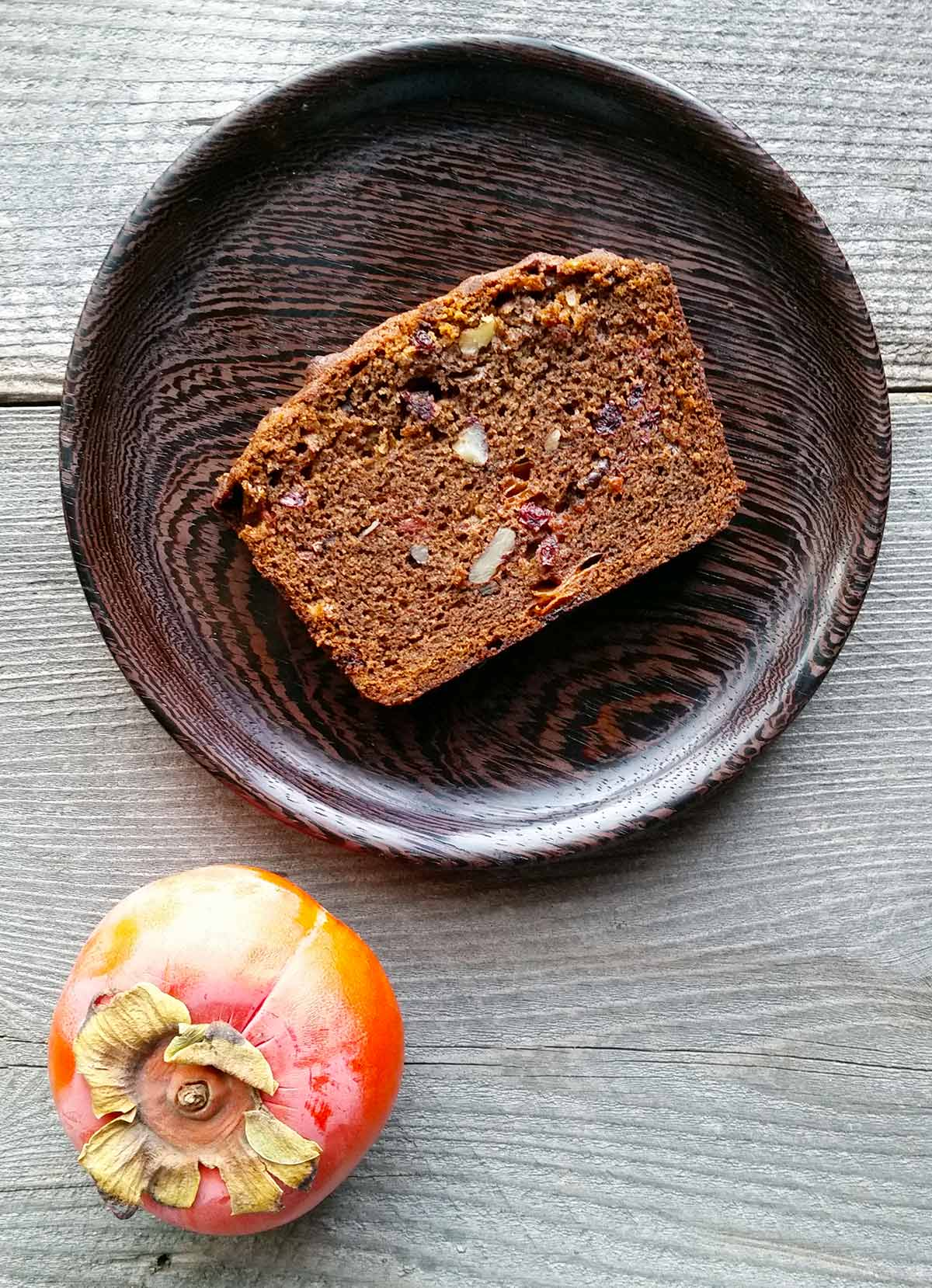 A slice of persimmon bread on a plate