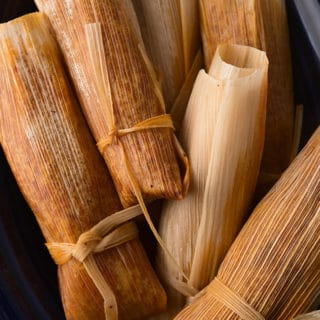 venison tamales wrapped in corn husks