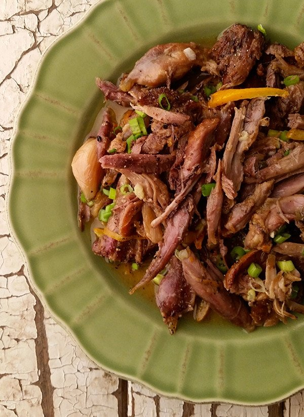 shredded goose recipe with lemon on the plate