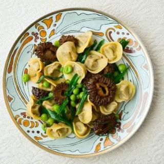 A plate of mushroom tortellini