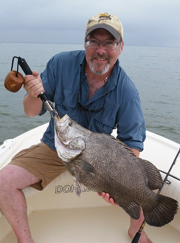 Hank Shaw with tripletail