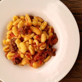 Bowl of malloreddus pasta with tomato sauce