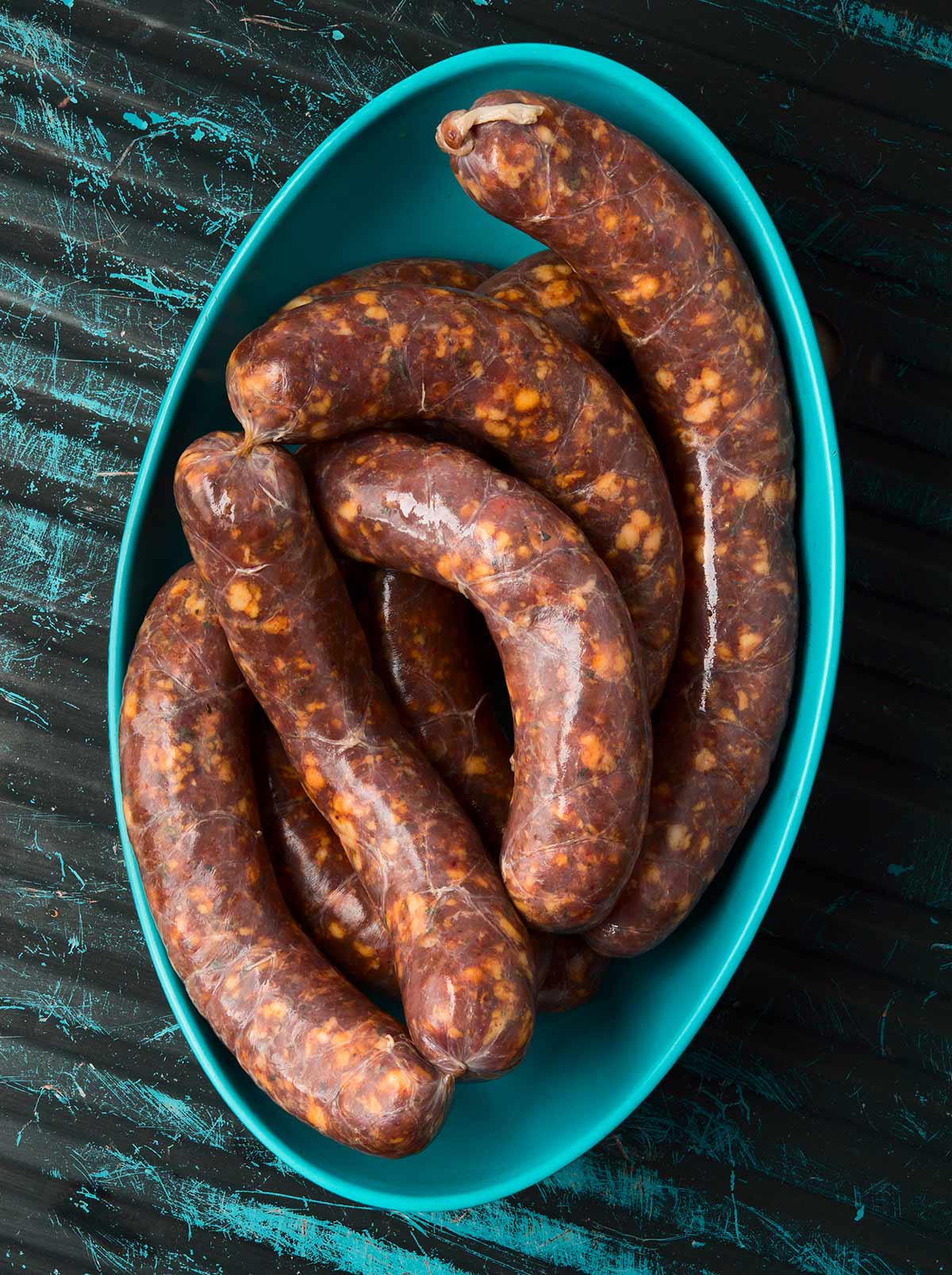 Links of spicy Italian sausage in a bowl