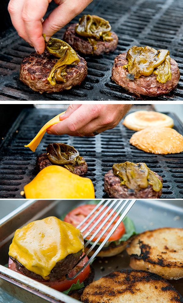 Constructing elk burgers on the grill, with chiles and cheese