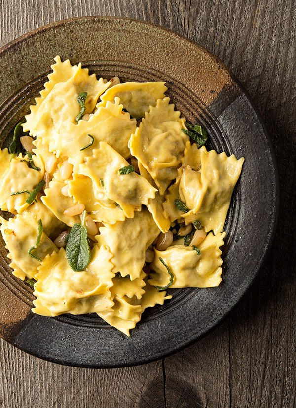 homemade agnolotti with meat on a plate