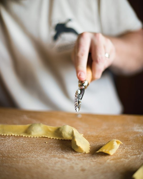 Cutting agnolotti with a rolling blade