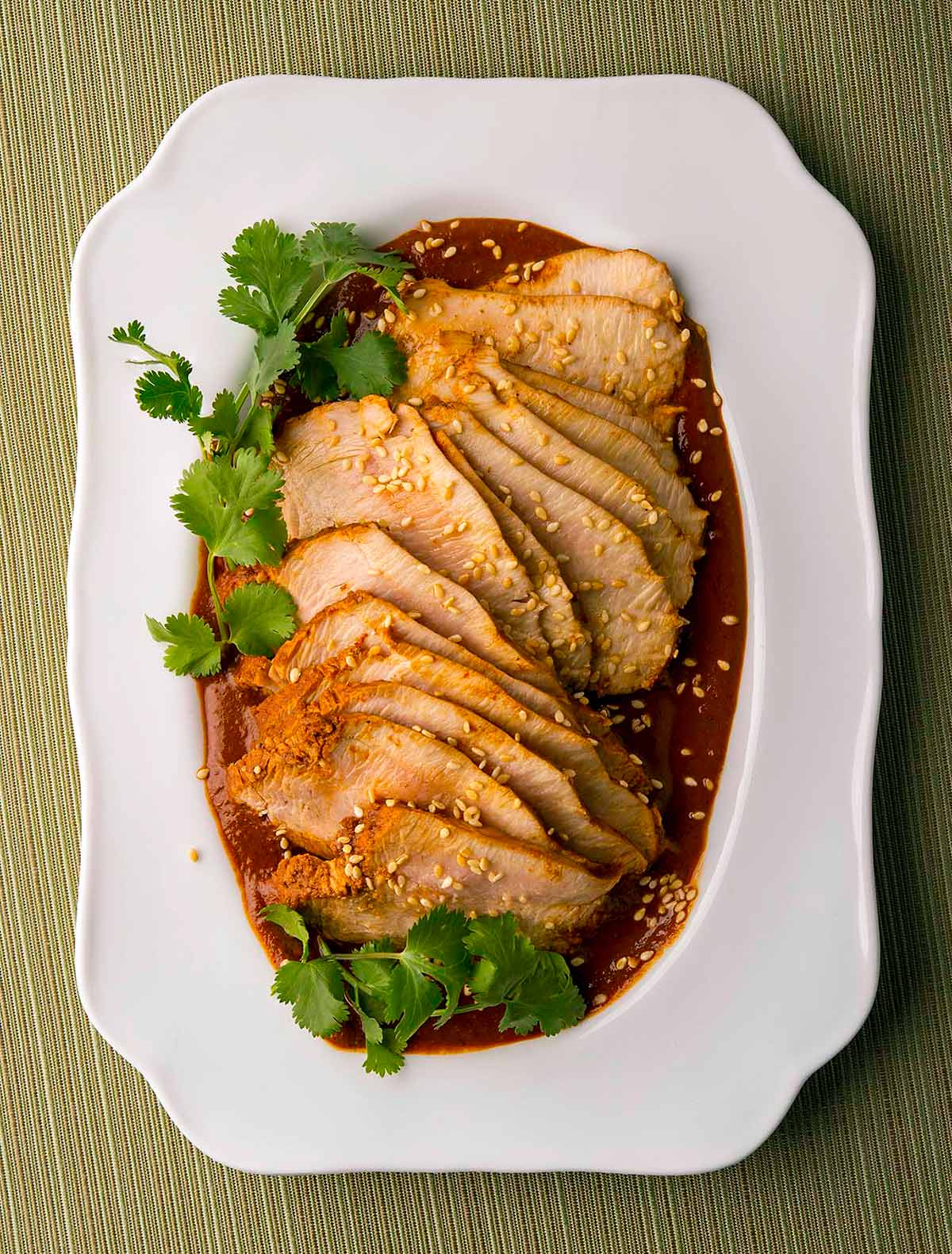 Slices of turkey breast with turkey mole sauce