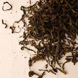 Dried fireweed tea on a plate.