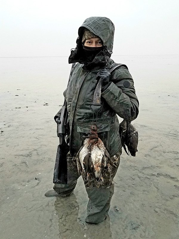 Holly Heyser with a strap of ducks