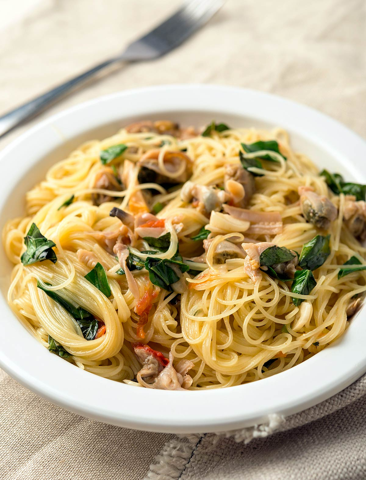 Pasta with white clam sauce on a plate