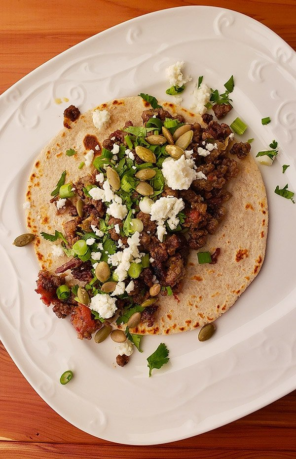 Sonoran style Mexican picadillo on a tortilla