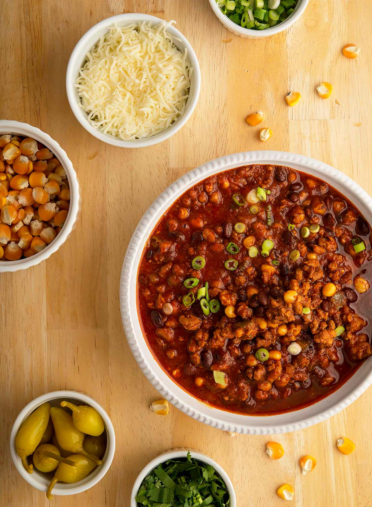 A bowl of turkey black bean chili with toppings