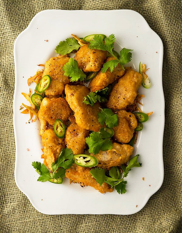 Chinese salt and pepper fish recipe, ready to eat on a platter