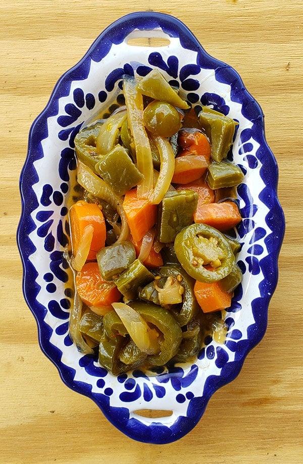 A bowl of nopales en escabeche