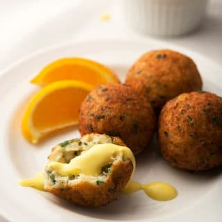 salt cod fritter with saffron aioli on the plate