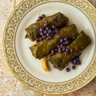 A serving of stuffed grape leaves on a plate