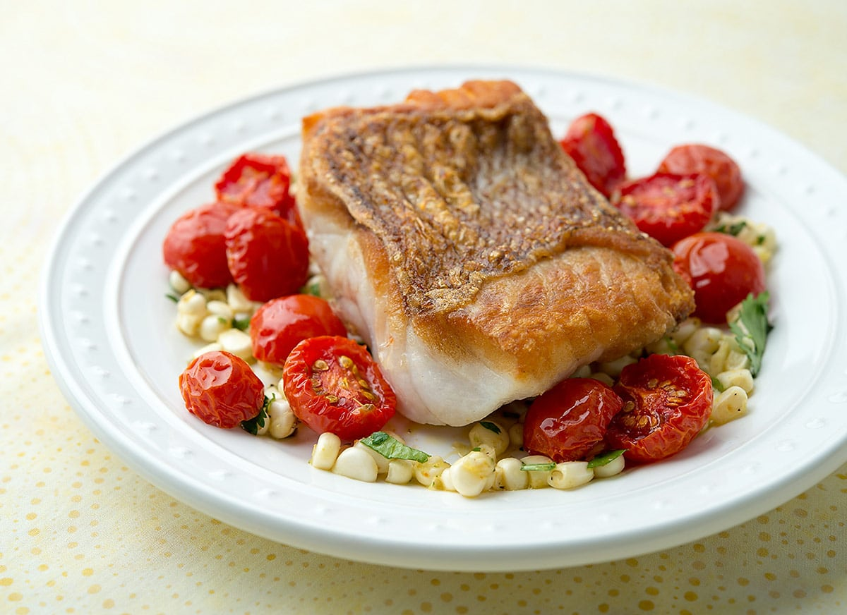 Seared red snapper with cherry tomatoes and corn