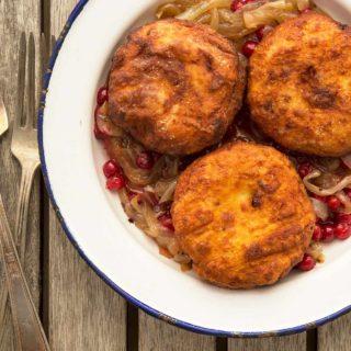 Fried Swedish potato dumplings with onions on a plate