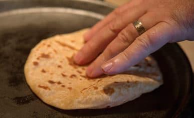 Flipping a homemade flour tortilla