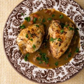 A red eye gravy recipe served with quail on a plate
