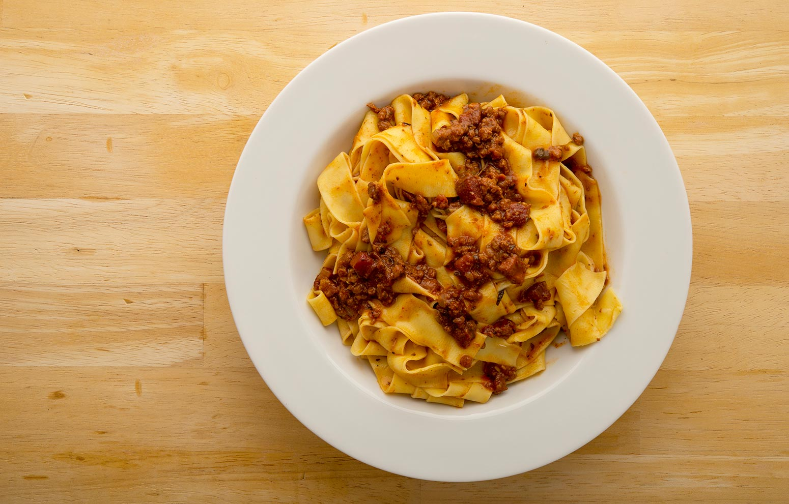 A bowl of homemade pasta and sauce.