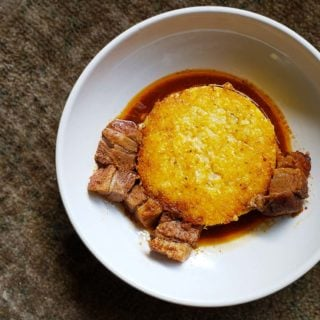 Leftover pork belly with fried hominy grits.