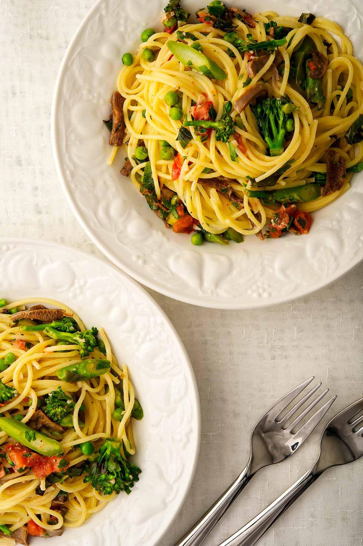 Two bowls of pasta primavera