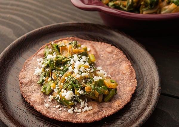 Tacos de quelites on a plate.