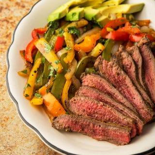 Finished flank steak fajitas recipe on platter