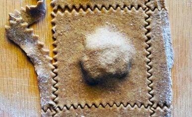 A close up of mushroom ravioli being made.