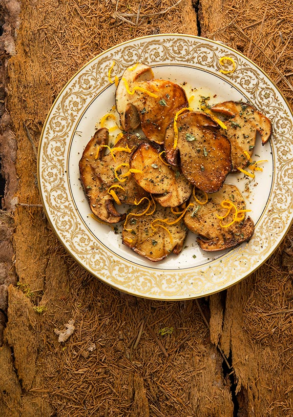 grilled porcini mushrooms on a plate.