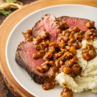 Venison with a French mushroom sauce on a plate