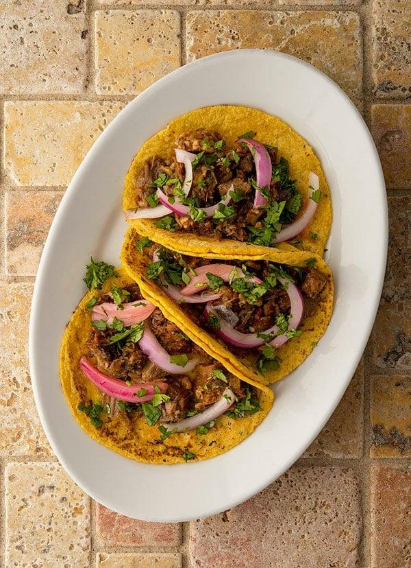 three tacos de cabeza on a plate