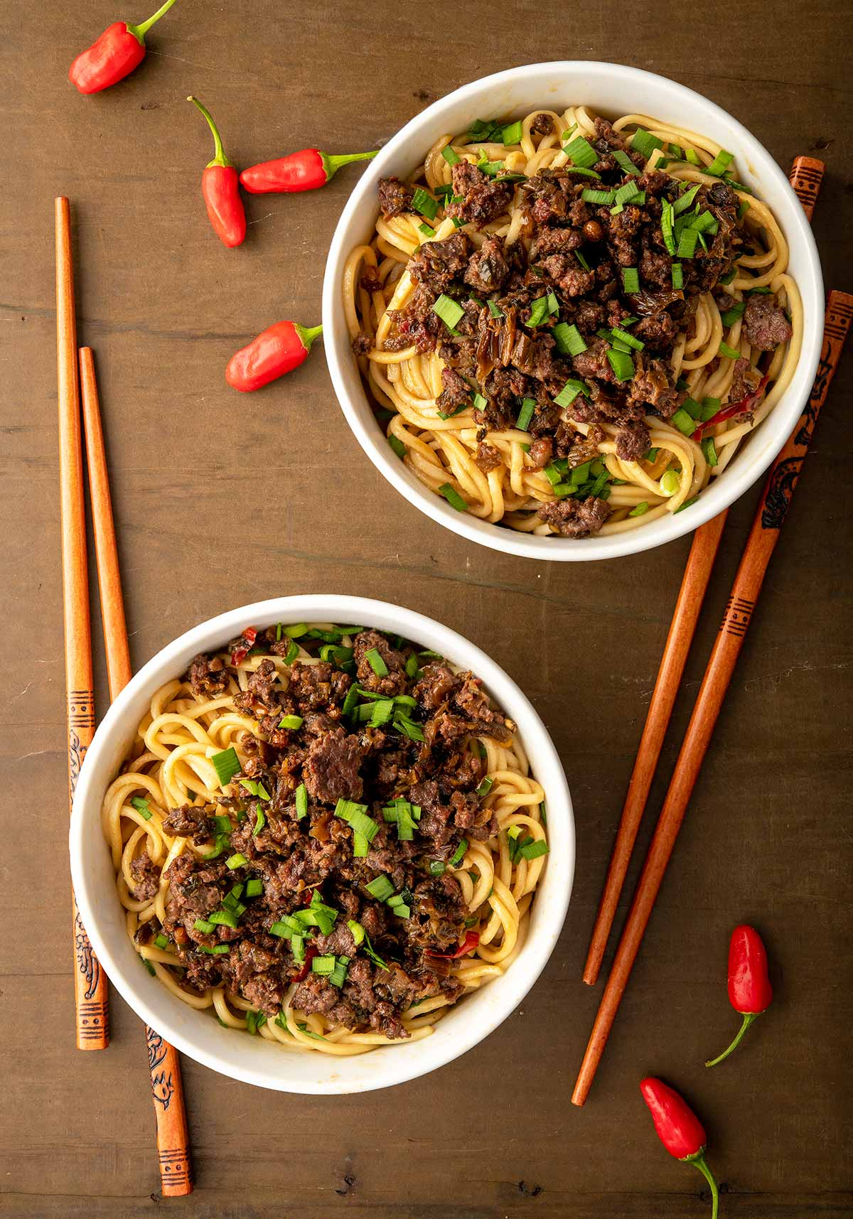 Finished dan dan noodles recipe, with two bowls
