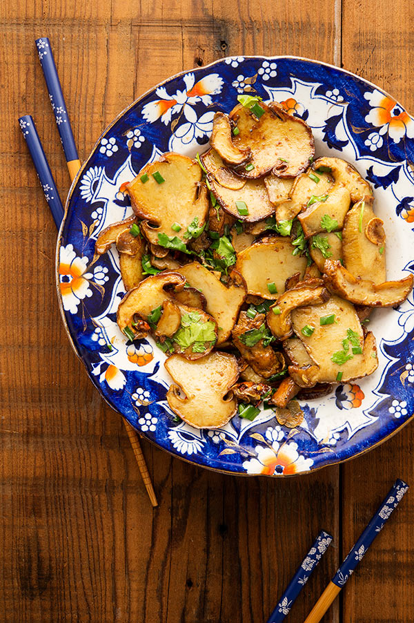 Mushroom stir fry in the bowl with chopsticks