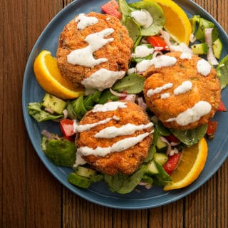 salmon cakes with horseradish cream and a summer salad