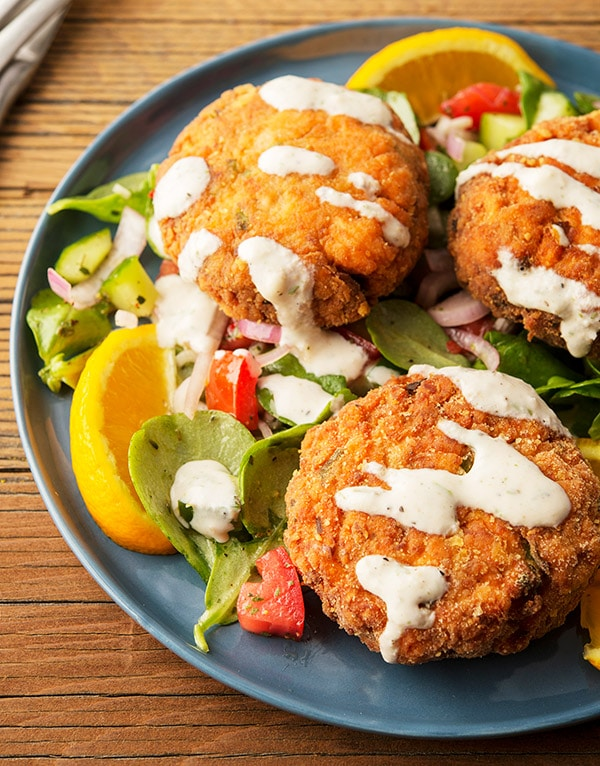 Close up of salmon cakes with horseradish cream