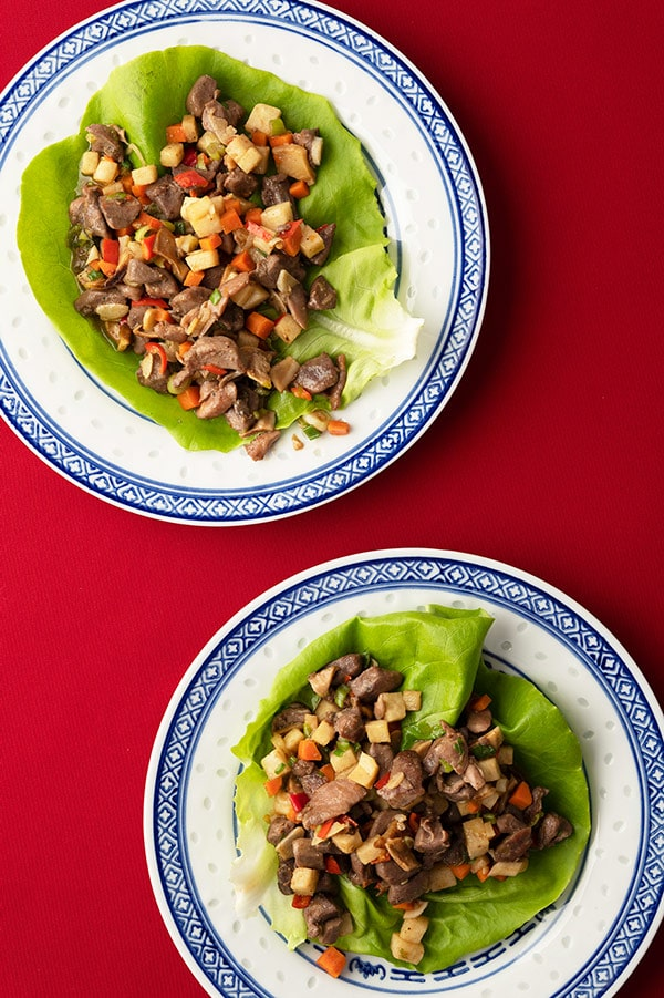 Two servings of Chinese lettuce cups with minced meat