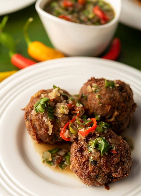 Closeup of three Thai meatballs on a plate