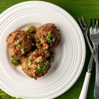 Three Thai meatballs on a plate