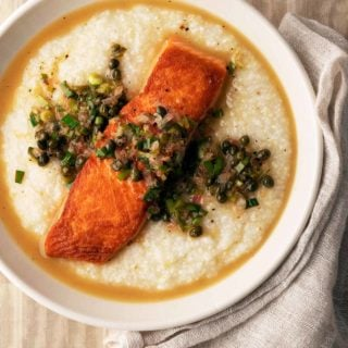 Salmon piccata served over grits