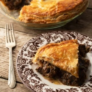 A slice of venison and kidney pie on a plate