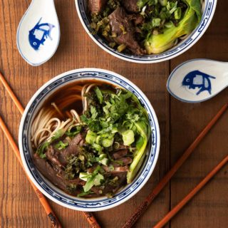Two bowls of Taiwanese beef noodle soup