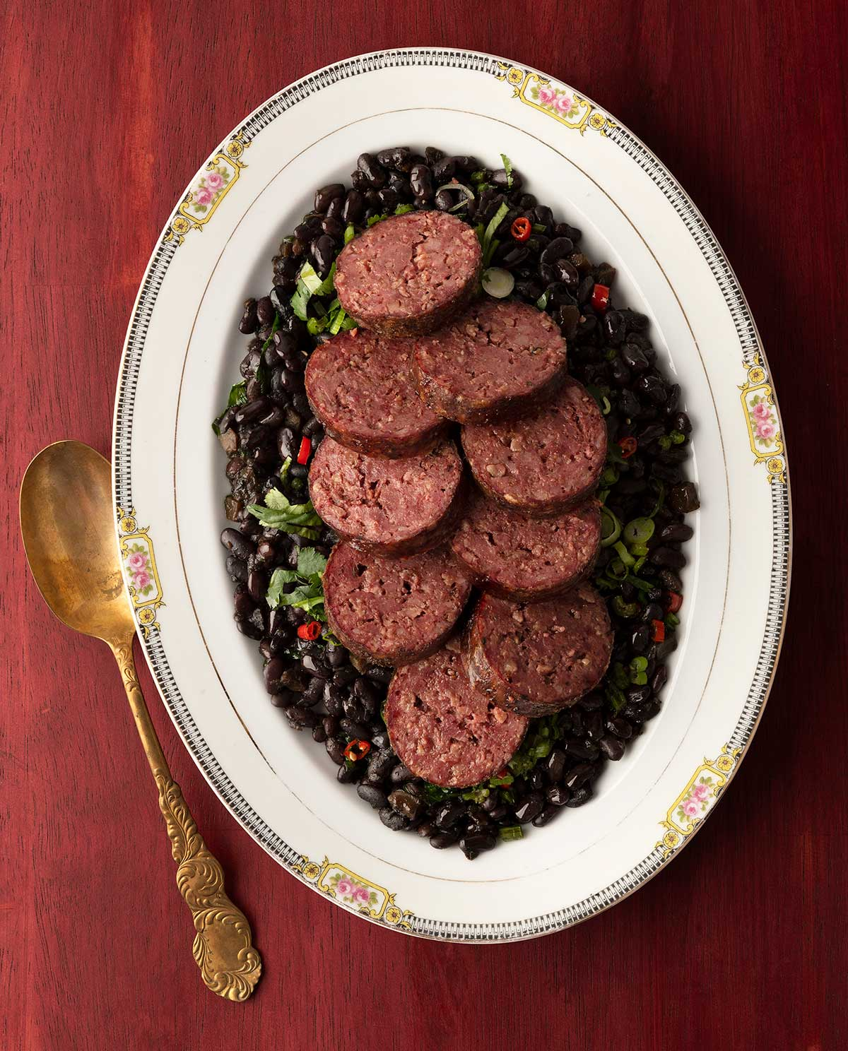 Cooked, sliced cotechino on a platter