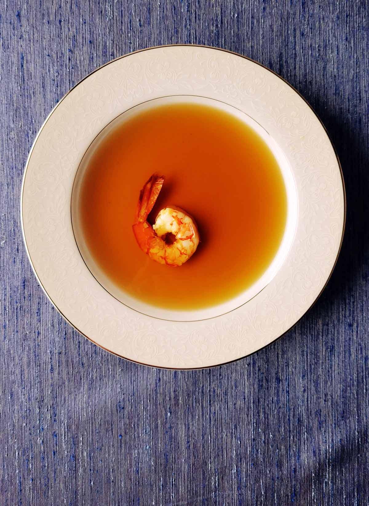 A bowl of shrimp stock