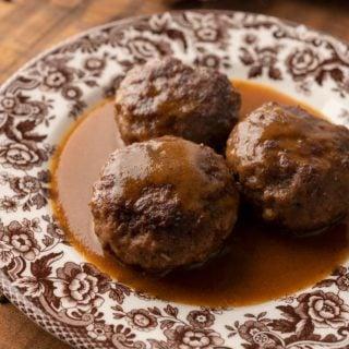 Closeup of a plate of Norwegian meatballs